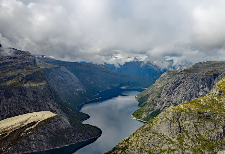 View from Trolltunga Norway Beauty In Nature Cloud - Sky Day Environment Landscape Mountain Mountain Range Nature No People Non-urban Scene Outdoors Power In Nature River Rock Rock - Object Scenics - Nature Sky Solid Tranquil Scene Trolltunga Norway Hiking Water