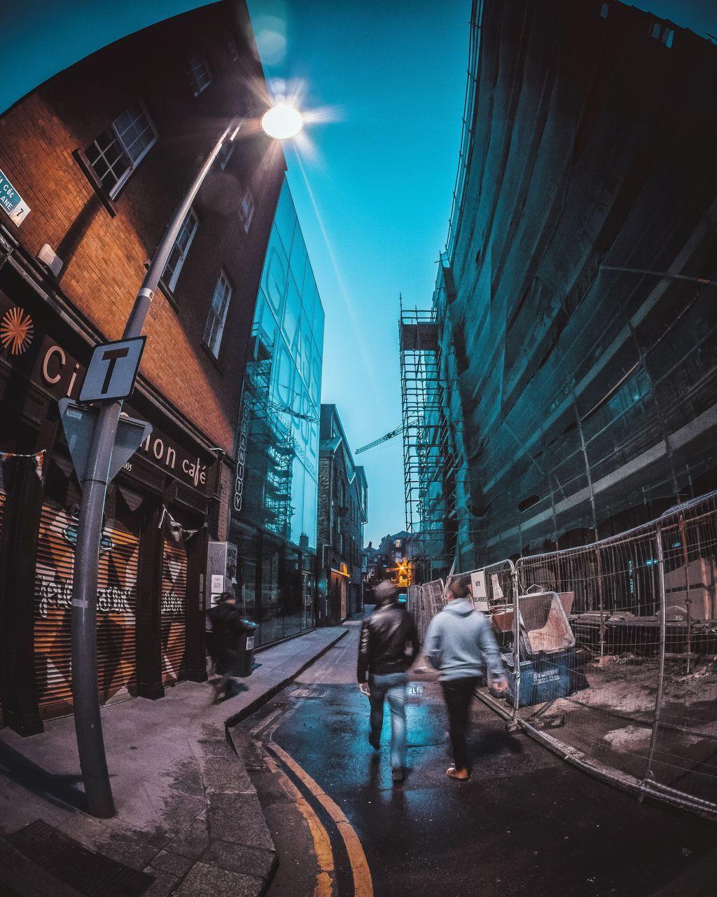 Fish-Eye Lens Of People Walking On City Street