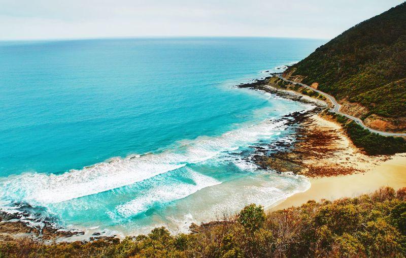 Land sea sand and sky Water Wave Sea Beach Sand Sky Horizon Over Water Rocky Coastline Coastline Calm Ocean Turquoise Cliff Shore Rock Formation