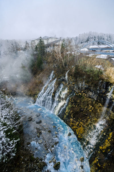 Shirogane hot spring village of Biei City, stands this 30m tall waterfall. The water flowing down the gaps between the rocks resembles a white beard, earning it the name Shirohige (white beard). Biei Emergency Furano Hokkaido Japan Nature Onsen Shirogane Tiffany Winter Beard Hot Spring Seascape Shirohigeshrine Snow Water Waterfall White