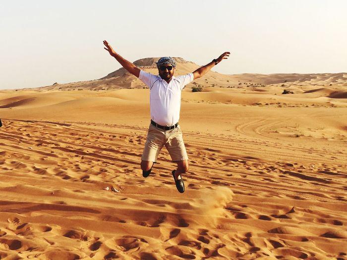 Full length of man jumping in desert