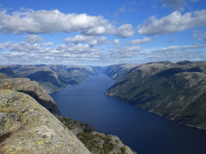 View Of Lysefjord From Preikestolen Against Cloudy Sky