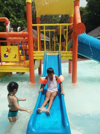 beat the heat this summer. Swimming Family Son Kiddiepool Summer EyeEm Selects Child Childhood Boys Tree Playing Happiness Water Slide Outdoor Play Equipment Togetherness Full Length