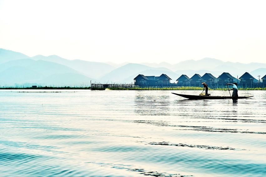 Mountain Nautical Vessel Nature Transportation Boat Scenics Water Tranquility Beauty In Nature Outdoors Mountain Range Tranquil Scene Mode Of Transport Lake Day Sky Landscape Clear Sky Real People Rowing Myanmar Inle Lake