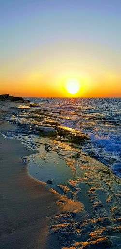 North coast, Alexandria, Egypt Water Sea Sunset Low Tide Beach Yellow Horizon Sun Sky Horizon Over Water View Into Land Refraction Wave Dramatic Sky Romantic Sky Coast Water Vehicle Evening Atmospheric Mood Calm Majestic Atmosphere Dramatic Landscape Moody Sky Seashore Sky Only Seascape Sightseeing Meteorology Tide