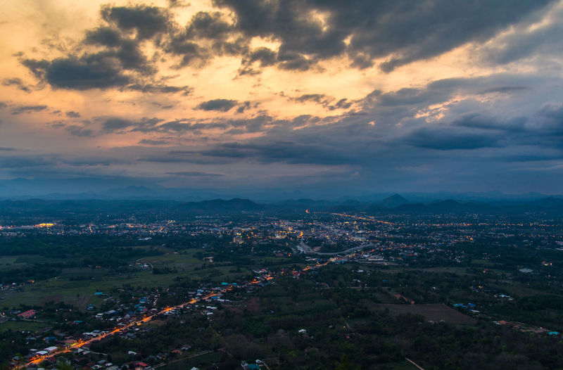 Landscape top view city in rural / Viewpoint on beautiful sunset twilight sky and lighting with yellow cloud and mountain background - Phu Bo Bit , Loei , Thailand Above Aerial Architecture Background Bangkok Beautiful Beauty Blue Bright Building City Cityscape Color Dusk Europe Forest Garden Green House Johannesburg Land Landmark Landscape Light Morning Mountain Natural Nature Night Outdoor Park Road Rock Season  Sky Skyline Street Summer Sun Sunrise Sunset Thailand Top Tourism Town Travel Tree Urban View Viewpoint