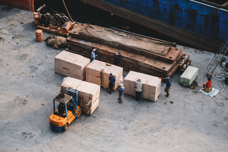 High Angle View Transportation Industry Occupation Container Machinery Day Business Box Mode Of Transportation Wood - Material Freight Transportation Men Outdoors Equipment Construction Industry Working Stack Manufacturing Equipment Box - Container Construction Equipment