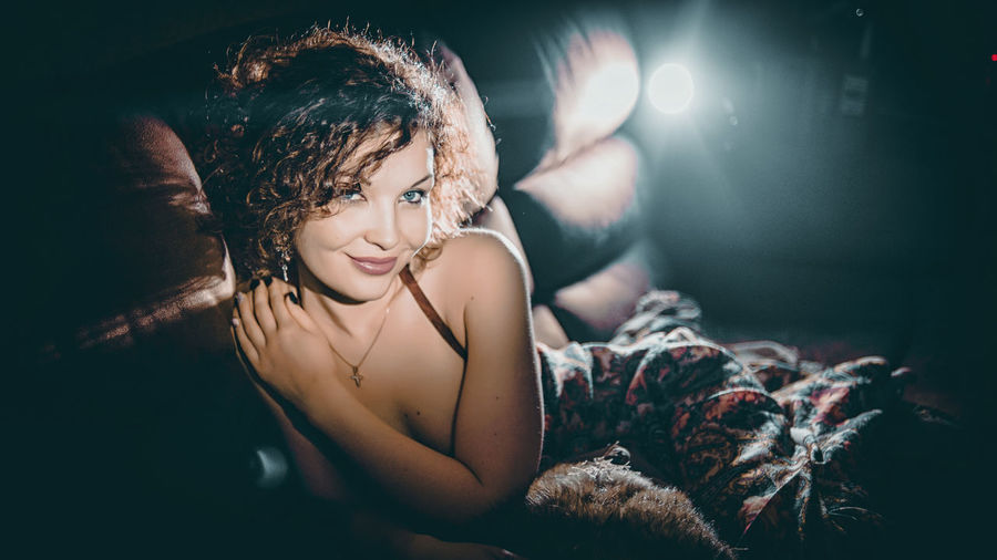 Young woman in illuminated hair at night