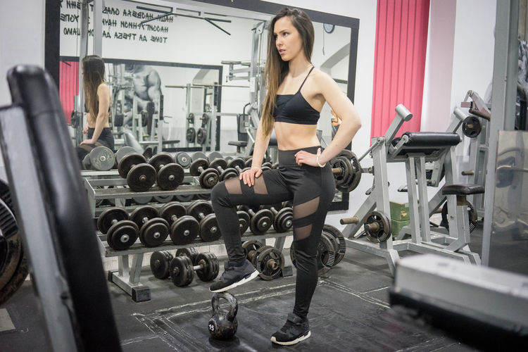 Full Length Of Young Woman Standing At Gym