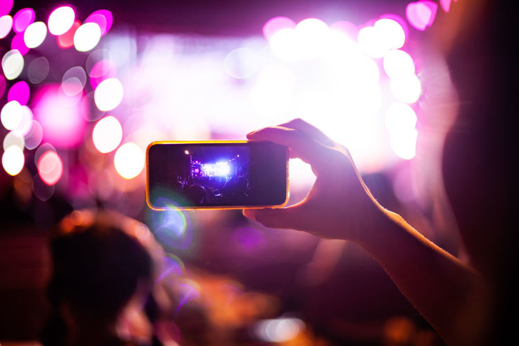 People taking photographs with smart phone during Live music concert and crowd in background Dance Event Fun Happy Show Singer  Stage Backgrounds Bokeh Communication Concert Crowd Digital Camera Disco Entertainment Hand Human Hand Mobile Phone Night Nightclub Nightlife Party Smart Phone Technology Technology Photography