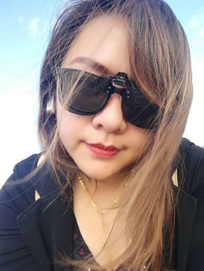 Close-up portrait of beautiful woman wearing sunglasses