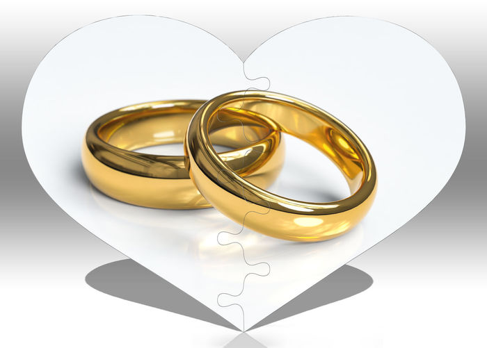 Love Gold Colored Emotion Ring Heart Shape Jewelry Wedding Ring Wedding Still Life Positive Emotion Gold Indoors  Celebration No People Event Close-up Metal Shape White Background Design Silver Colored Personal Accessory Wedding Rings Puzzle  Puzzles