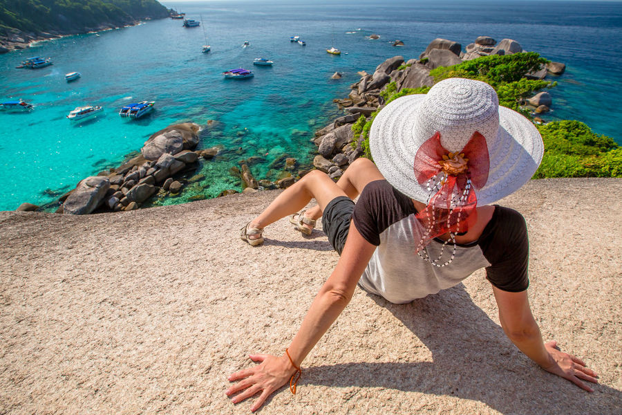 Back of happy and fashionable tourist woman with colorful sarong in turquoise water of Maya Bay famous lagoon of The Beach movie, Phi Phi Leh, Andaman Sea in Thailand Fashionable and happy tourist with sarong and pink wide-brimmed hat making a selfie on tropical famous beach of Nai Harn Beach, Rawai, Phuket, Thailand. Happy tourist enjoys panorama from Sail Rock View Point of kor 8 of Similan Islands National Park, Phang Nga, Thailand, one of the tourist attraction of the Andaman Sea. Happy woman with bikini and shorts, jumping in the air on Ya Nui Beach, a little cove divided by a rocky cape, Phuket, Thailand, Asia. Happy Koh Rok Islands Nui Beach Phang Nga Bay Phuket Thailand Tanning ☀ Thailand Vacations Woman Adult Adults Only Beach Carefree Day Enjoyment Full Length Girl High Angle View Koh Rok Leisure Activity Nature Only Women Outdoors People Phang Nga Rawai Real People Sea Seascape Sitting Summer Surin Islands Travel Destinations Vacations Water Women Young Adult Young Women