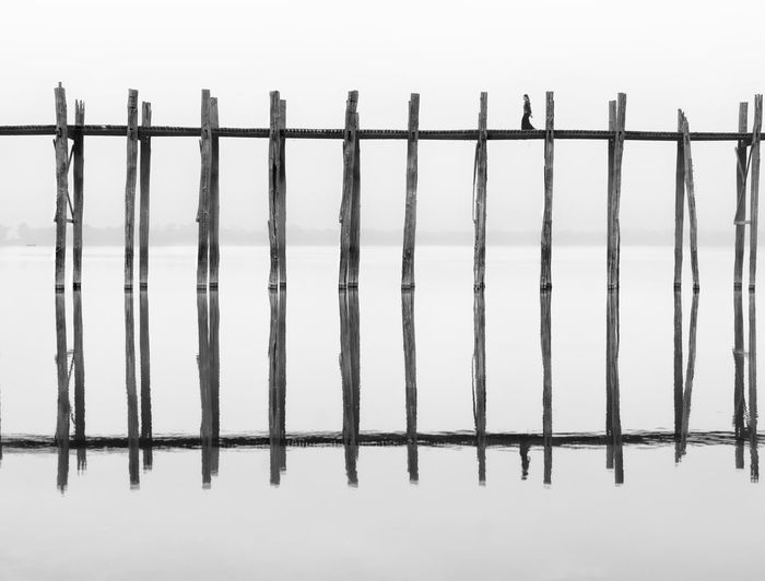 Close-up of metal fence during winter
