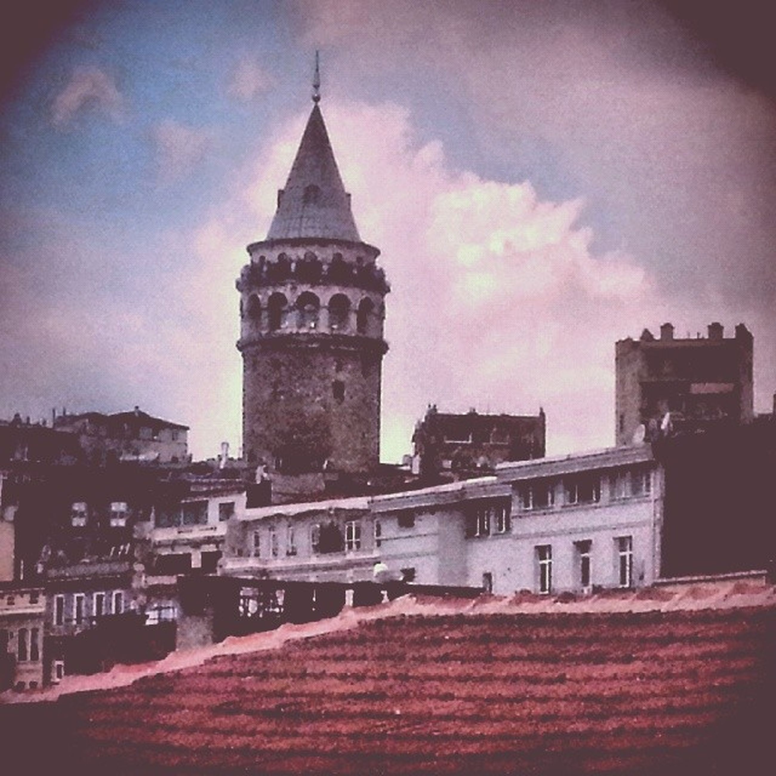 architecture, building exterior, built structure, sky, low angle view, cloud - sky, tower, clock tower, church, city, religion, dusk, travel destinations, place of worship, famous place, history, cloudy, outdoors, cloud