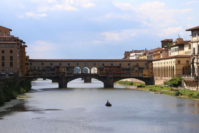 old Bridge called Ponte Vecchio in Florence Italy and a boat in arno river #Firenze Ancient Arno  City Cityscape Firenze Monuments Old Bridge Ponte Vecchio - Firenze Sightseeing Toscana Tuscany Bridge Bridge - Man Made Structure Italian Monumen Monument Old Ponte Vecchio River Tourism Town Travel Destinations Water