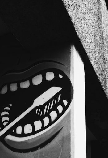 Ghosts with faces 2: Brushing Columns. Ghosts With Faces Face Faces In Places Graffiti Black & White Minimal_perfection Minimalobsession Street Photography Urbanexploration Berlin Photography Low Angle View No People Close-up Teeth Brush Teeth Dentist Tooth Brush City Street Street Photo Bnw Blackandwhite Good Morning