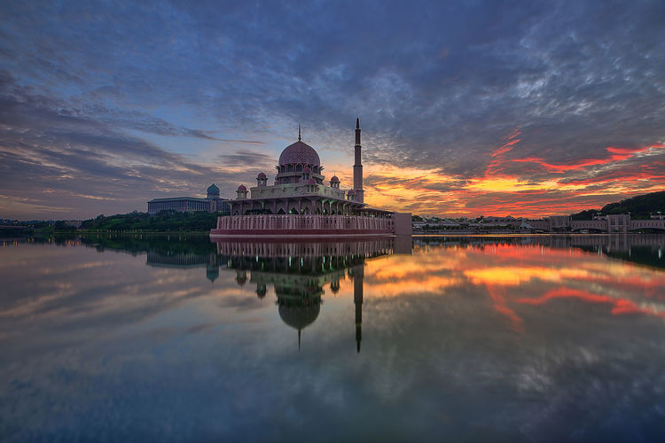 Reflection of temple in water at sunset