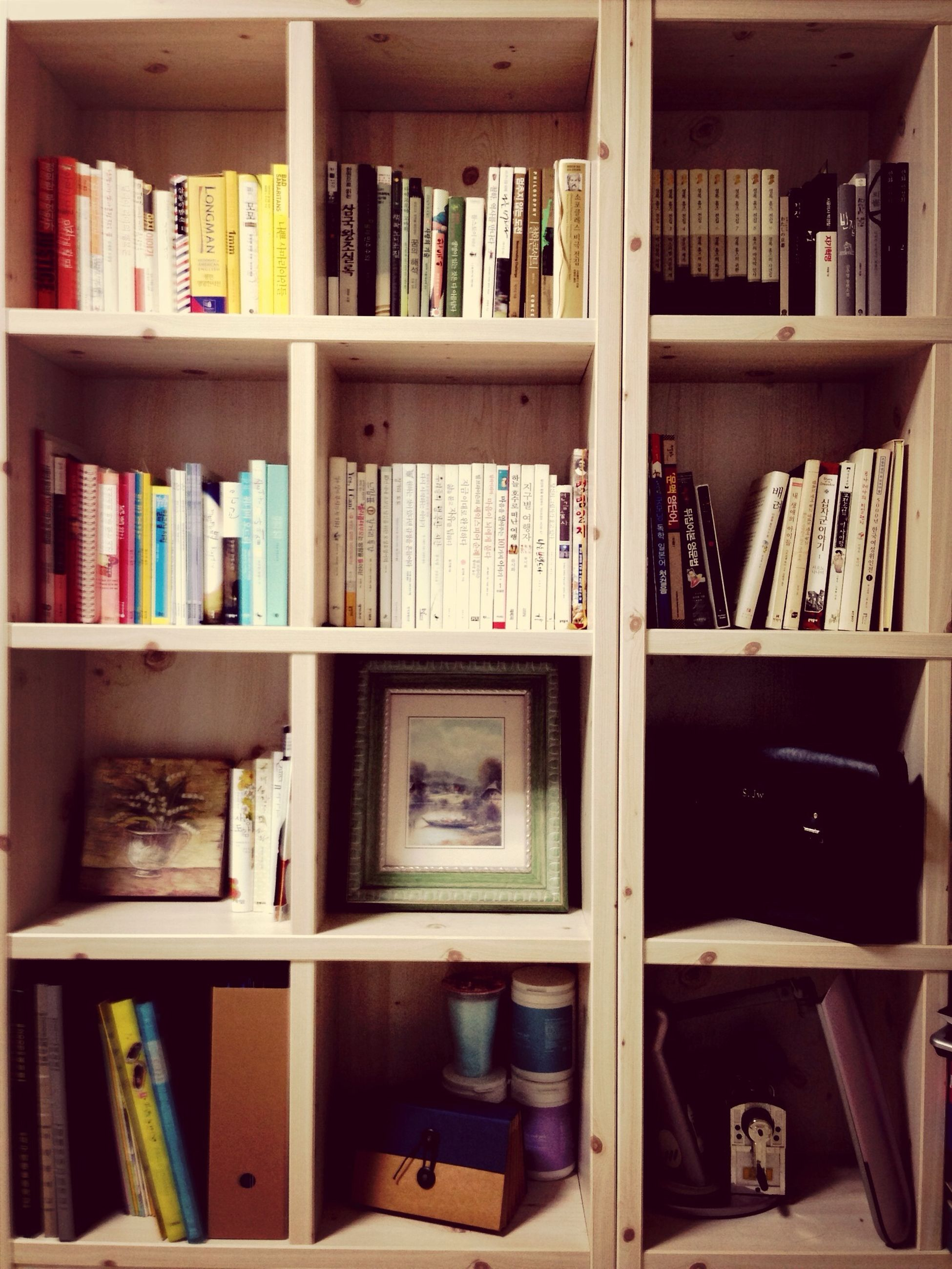 indoors, shelf, large group of objects, book, variation, bookshelf, arrangement, abundance, choice, order, education, still life, in a row, collection, stack, wood - material, desk, table, literature, store