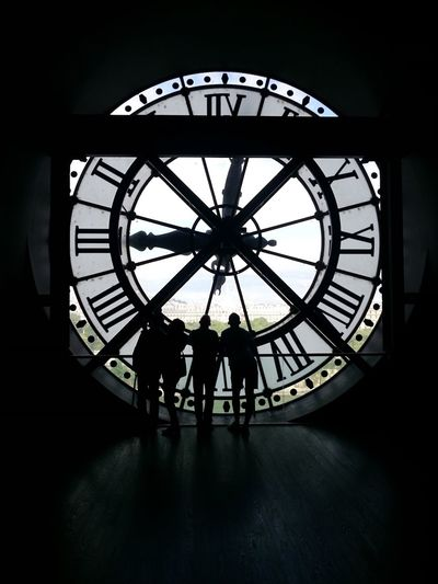 Silhouette people standing in a clock tower