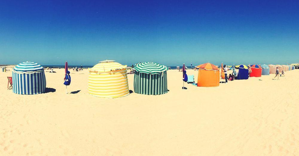 Sandy Beach Against Clear Blue Sky