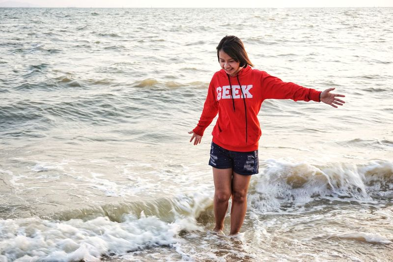 Beach One Person Sand Sea Wave People Standing Outdoors Horizon Over Water Vacations Nature Cute Girl Smiling Looking At Camera Water Summer Happiness Cheerful Teenager Sunlight Leisure Activity Smiling Girl Lively Lovely Asian Girl