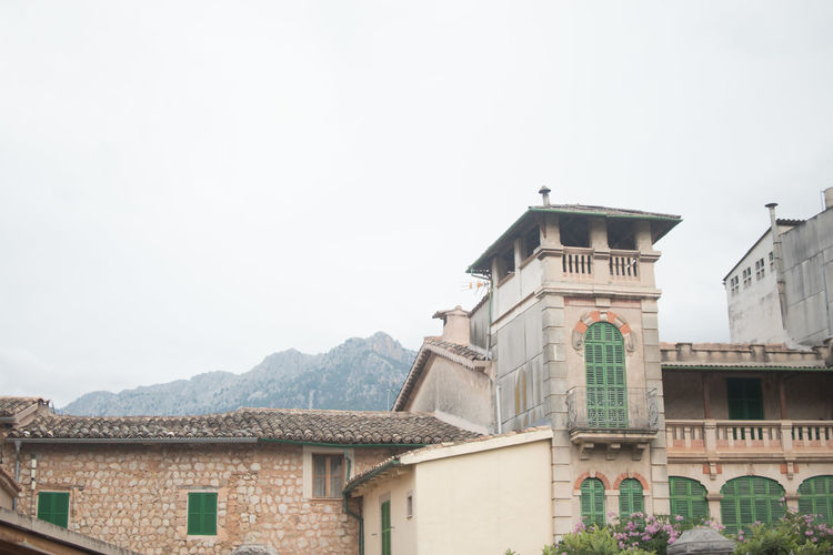 Architecture Building Building Exterior Built Structure Clear Sky Copy Space Day High Section House Low Angle View Mallorca Mountain No People Outdoors Postcard Residential Building Residential Structure Roof Sightseeing Sky SPAIN Travel Tree Vacation Window
