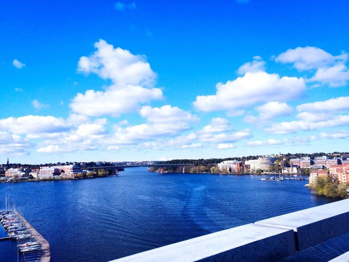 Architecture Built Structure Building Exterior Sky Water Cloud - Sky River Day Outdoors City Blue Cityscape Travel Destinations Town Nature Beauty In Nature Bridge View Tranebergsbron View View Stockholm May 2017 EyeEm Gallery