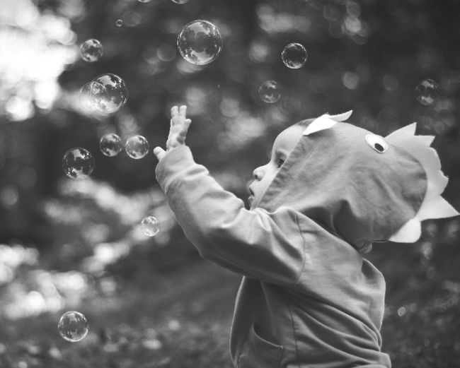 Side view of baby boy with soap bubbles