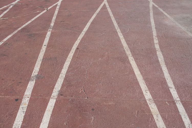Athlete Run Running Athletism Backgrounds Competition Competitive Sport Day Direction Dividing Line Full Frame High Angle View Marking No People Outdoors Pattern Road Road Marking Running Track Sign Sport Sports Sports Track Symbol Track And Field