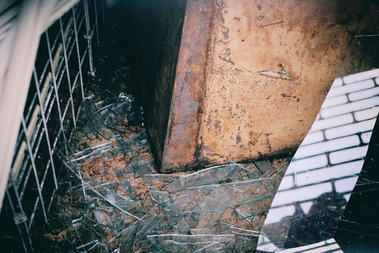 High Angle View Of Shattered Glass In Abandoned Building