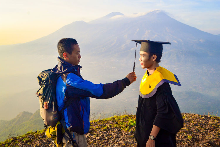 Graduation People Two People Mountain Range EyeEm Best Shots Two People Togetherness Adult Nature Women Females Men Sky Landscape Mountain Males  Smiling Child Land Rural Scene Emotion People Standing Outdoors Family