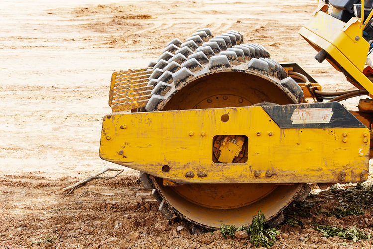 Close-up of yellow abandoned truck on field