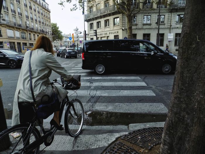 Paris Paris, France  City Full Length Land Vehicle Bicycle Car City Life Street City Street Road Women Taxi Traffic Jam Zebra Crossing Parking Crosswalk Bicycle Rack Road Marking Road Intersection Rush Hour Traffic Cycling Riding