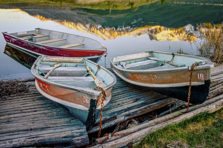 Fishing boats moored on shore at beach
