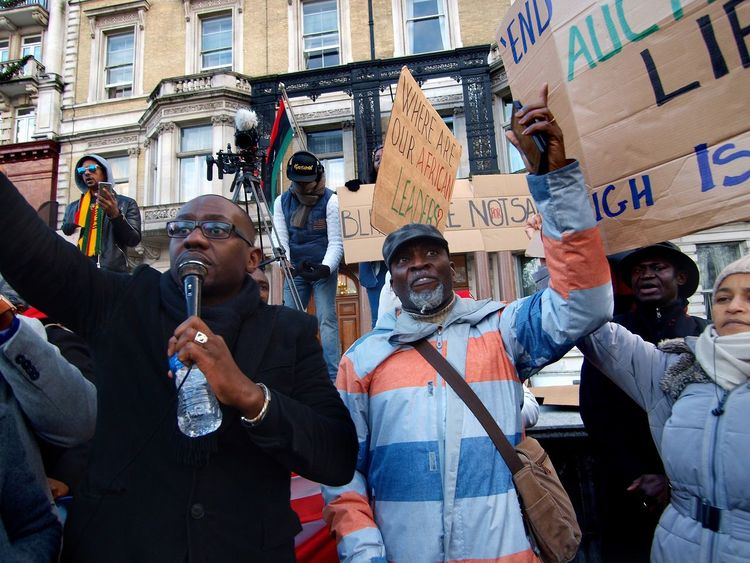 No Borders! No Slavery! Protest demanding an end to auctioning of black Africans in Libya. Following reports of people auctions in Libya. Libyan Embassy. London. UK. 26/11/2017 People Auctions Photojournalism No Borders! No Slavery! Stevesevilempire Steve Merrick London Slavery Black Lives Matter Slavery Still Exists Protesters London News Protestor Olympus Zuiko Protest Libya