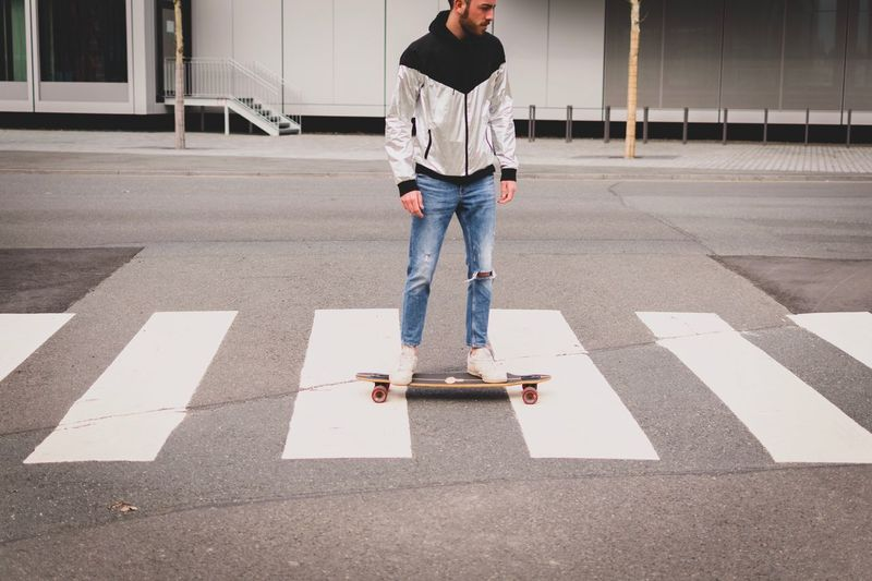 Young Men Skateboarding Skateboard Urban One Person Full Length Symbol Road City Sign Day Road Marking Standing Men