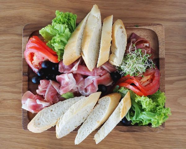 Plate of deliciousness Food And Drink Food Bread Still Life Directly Above Freshness High Angle View Table Indoors  Healthy Eating Tomato No People Ready-to-eat Meat Vegetable SLICE Plate Wooden Ham Parma Ham Healthy Fingerfood Delicious Tasty Lettuce