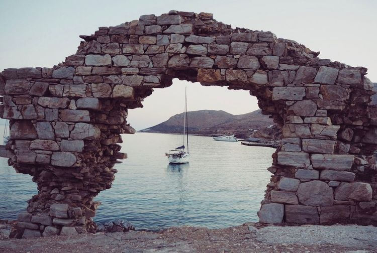 Whos there Water Sky Transportation Nautical Vessel Mode Of Transportation Architecture Nature Solid Day Clear Sky Sea Built Structure Rock Travel Arch Rock - Object No People Outdoors Sailboat Stone Wall