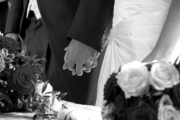 Black And White Bonding Bouquet Bride Bridegroom Celebration Celebration Event Ceremony Flower Groom Hand Human Body Part Indoors  Life Events Low Section Men Real People Togetherness Two People Wedding Wedding Wedding Ceremony Wedding Dress Well-dressed Women