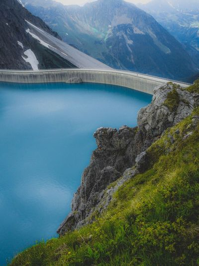 High angle view of bridge by river against mountains