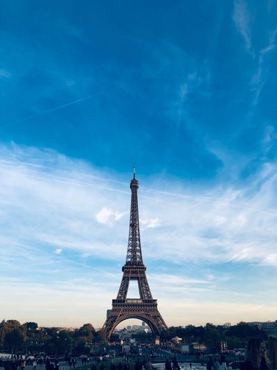 Low angle view of eiffel tower against blue sky during sunset