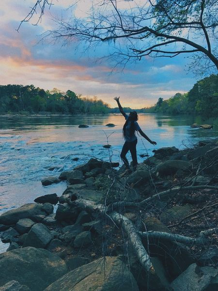 Full Length Water One Person Tree Nature One Woman Only Sky Sunset River Outdoors Beauty In Nature Real People Women Beach Adults Only Day People Adult Young Adult