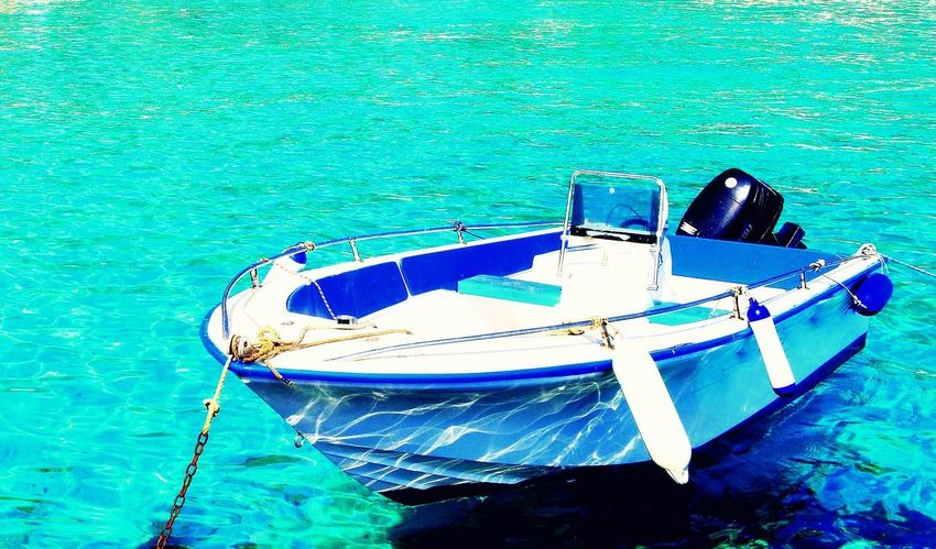 Mediterranean  The Week On EyeEm Boat Day Greece High Angle View Ionian Islands Ionian Sea Lifestyles Mode Of Transport Moored Nature Nautical Vessel No People Outdoors Paxos Sea Sea And Sky Summer Transportation Trasparence Water