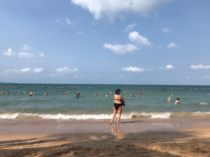 Water Beach Sea Land Sky Horizon Horizon Over Water Outdoors Beauty In Nature Scenics - Nature Leisure Activity Vacations Day Nature Lifestyles Holiday Real People Cloud - Sky Sand Trip