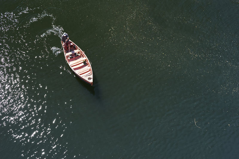 High angle view of man rowing boat on river