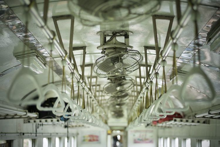 Low angle view of fans in train