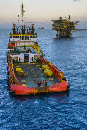 anchor handling job Anchor Handling Tug Boat Boat Ship Vessel Stern Able Bodied Seamen Offshore Offshore Life Safety Anchor Platform Oil And Gas Industry Nautical Vessel Water Sea Red Sky Horizon Over Water Oil Well Offshore Platform Oil Field Crude Oil Oil Industry Oil Natural Gas