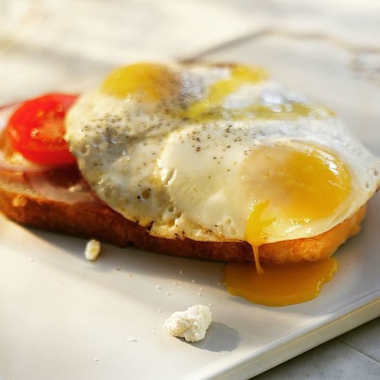 Close-up of fried egg on bread in plate