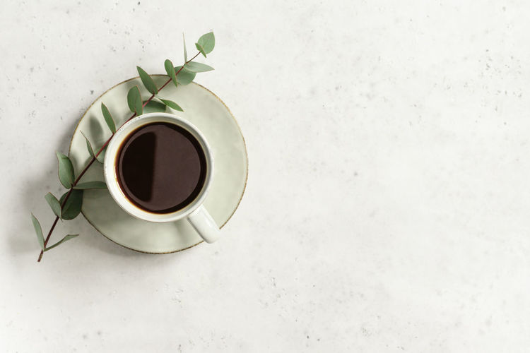 Drink Refreshment Food And Drink Cup Mug Coffee - Drink Coffee Coffee Cup Indoors  Freshness Saucer Crockery Directly Above Table Still Life High Angle View No People Copy Space Black Coffee White Color Non-alcoholic Beverage Tea Cup